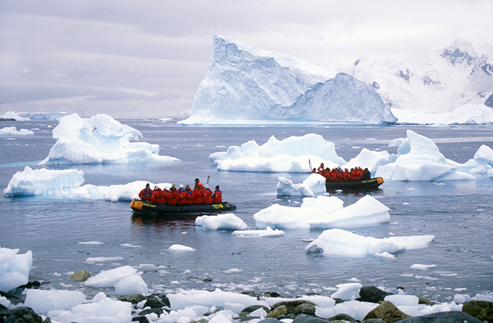 Cruise and tour Antarctica, frigid South Pole with penguins, icebergs.