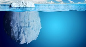 Half-submerged, large iceberg in Antractic Ocean.