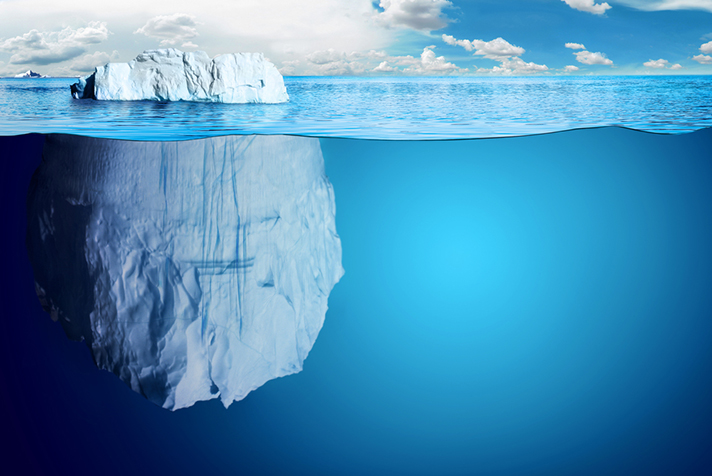 Half-submerged, large iceberg in Antractic Ocean.