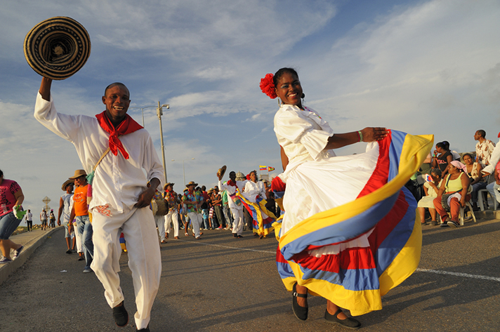Latin dance at the parade with rhythmic steps and musical beats.